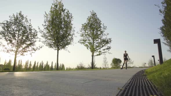 Thumbnail for Beautiful Young Woman On Rollerblading In Park At Sunrise