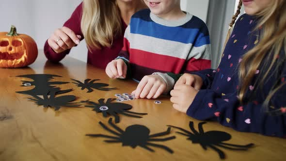 Thumbnail for Handheld video shows of family preparing decorations for Halloween