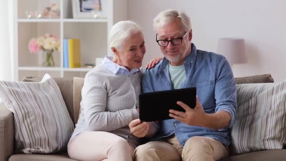Cover Image for Senior Couple Having Video Call on Tablet Pc 19