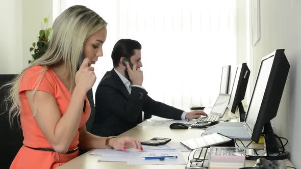 Woman and Man Phone and Work on Desktop Computer in the Office - Support - Telephone