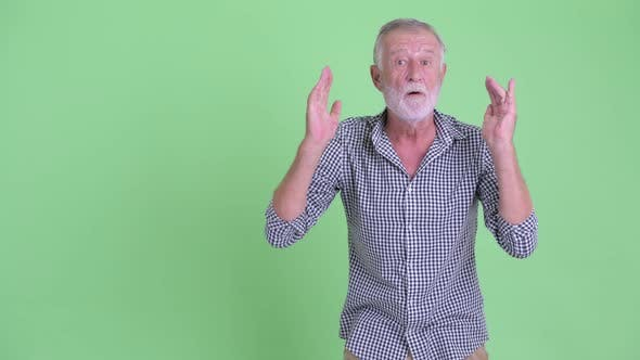 Thumbnail for Happy Senior Bearded Man Snapping Fingers and Looking Surprised