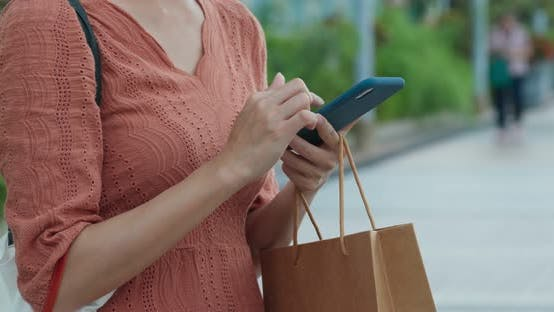 Cover Image for Woman hold shopping bag with cellphone