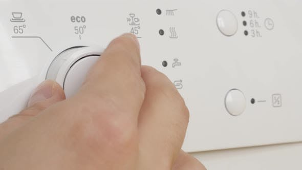 Manual dishwasher program setting  close-up 4K 2160p 30fps UltraHD footage - Console of dishware and