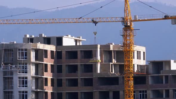 Thumbnail for Building Construction, Tower Crane on a Construction Site Lifting Wall Panel