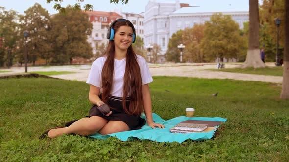 Thumbnail for Girl Listen Song Resting Outdoors