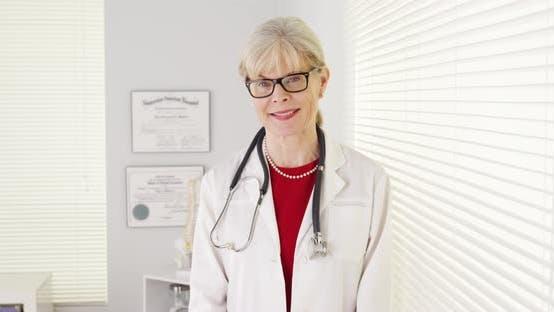 Thumbnail for Woman doctor smiling at camera