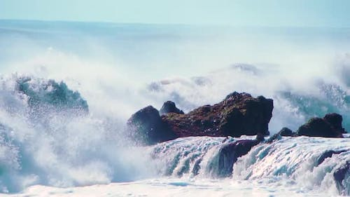 Wall of Water and Turbulent Waves of Pacific Ocean and Rugged Beauty of Basalt Rocks Reef and Cay