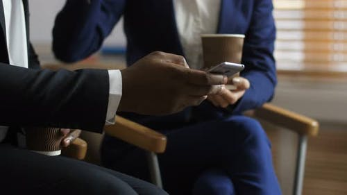 Midsection of Diverse Colleagues Looking at Phone