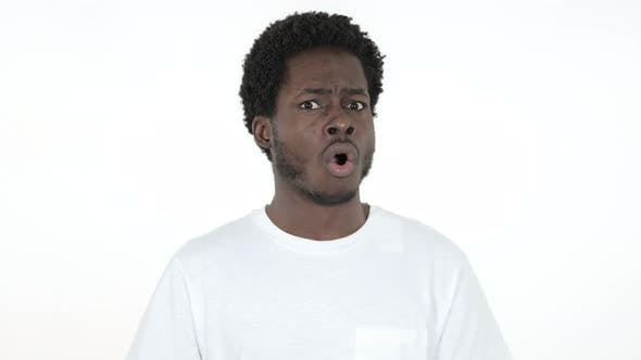Thumbnail for Shocked Surprised African Man Standing, White Background in Wonder