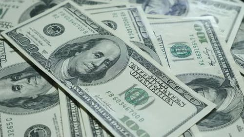 Money american hundred dollar banknotes on background