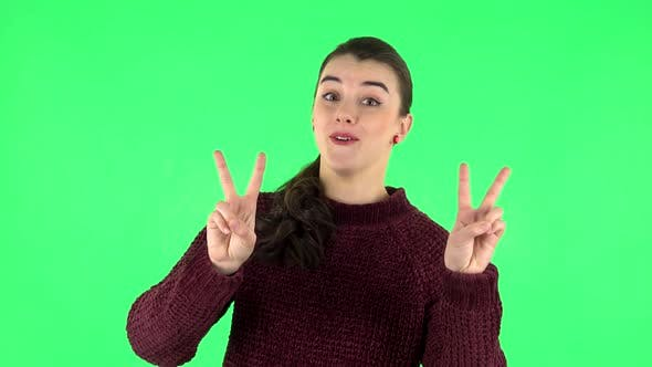 Thumbnail for Girl Shows Two Fingers Victory Gestur. Green Screen