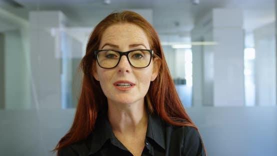 Thumbnail for Businesswoman explaining chart in a modern office 4k