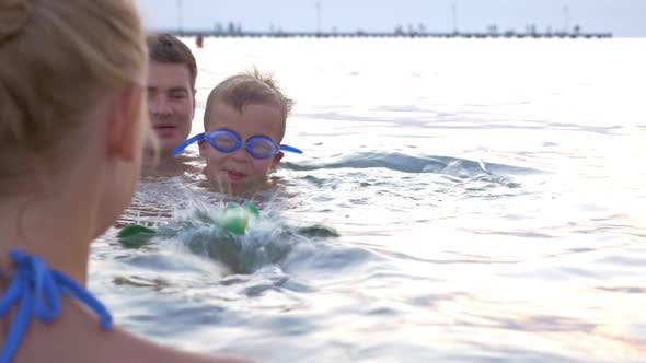 Thumbnail for Family Playing with Swimming Toy in Sea