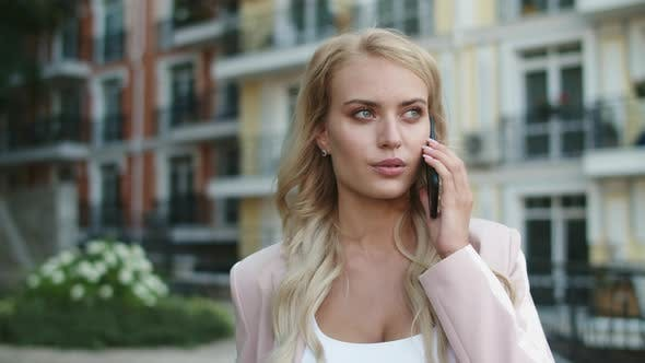 Thumbnail for Closeup Businesswoman Walking in Suit. Businesswoman Talking Phone Outdoors