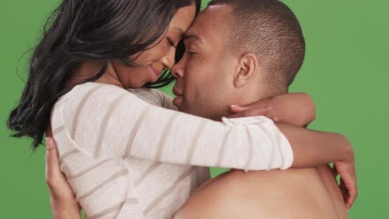 Thumbnail for Romantic loving couple embracing each other on green screen