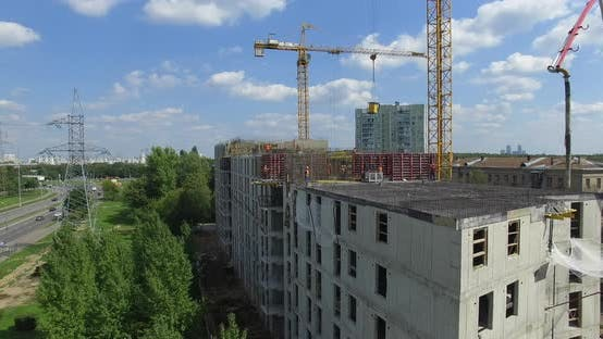 Thumbnail for Aerial View of Unfinished Apartment House with Builders Working