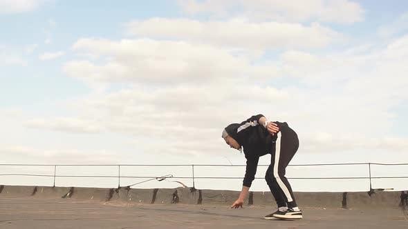 Thumbnail for Dancer Guy Dancing Break Dance on the Roof