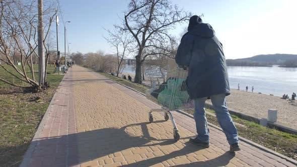 Thumbnail for Homeless Man Pushing Shopping Cart