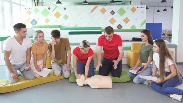 Caucasian People Practice an Exercise of Resuscitation During Lesson