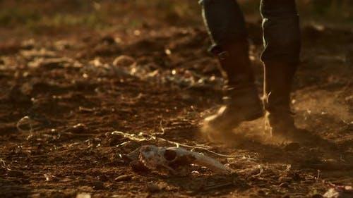 Crop Farmer Walking on Dry Soil