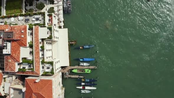 Top Down View of Moored Empty Venetian Gondolas in Venice Italy