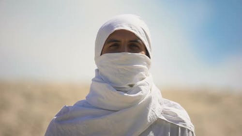 Bedouin in White Clothes Looking on Camera, Islamic Religion and Traditions