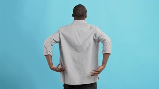 Thumbnail for Black Man Holding His Hands Behind His Back, Stretching Spine