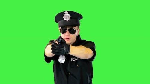 Policeman in Uniform Runs Aiming with a Gun on a Green Screen Chroma Key