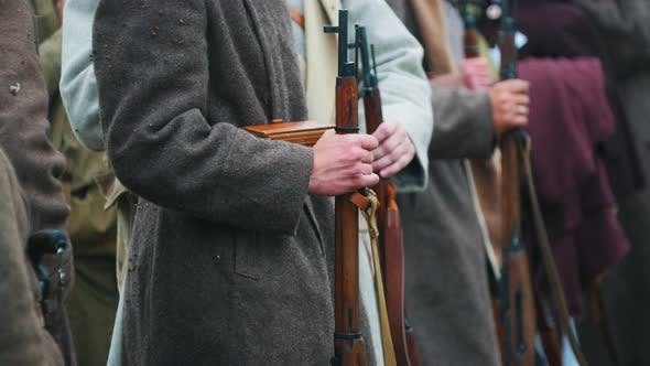 Thumbnail for Men Soldiers in Coats Standing in the Row Holding Guns - Clapping with Frozen Hands