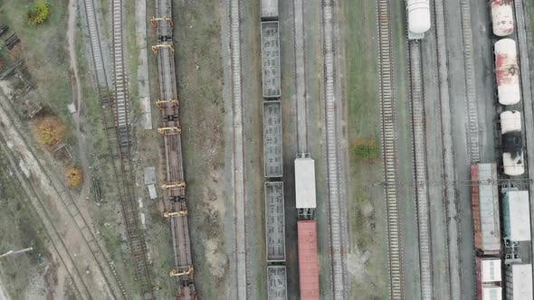 Thumbnail for Aerial view of cargo railway station filled with trains and cargo wagons
