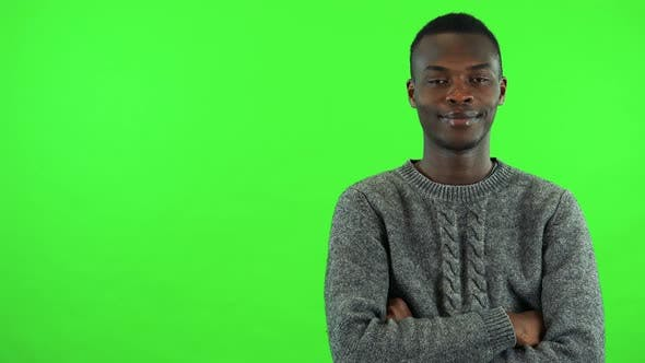 Thumbnail for A Young Black Man Crosses His Arms Over His Chest and Smiles at the Camera - Green Screen Studio