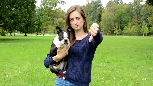 Thumbnail for Young Attractive Woman Hug French Bulldog and Show Thumb Down - Disagree
