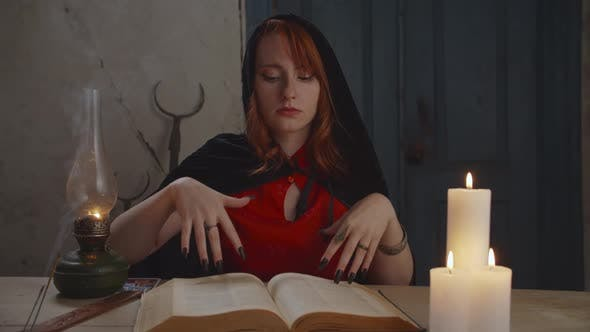 Thumbnail for Portrait of Mysterious Sorceress with Magic Book