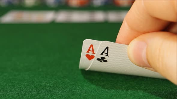 Thumbnail for POKER: The player's hand looking his cards in the game