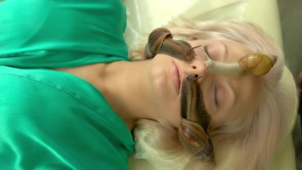 Therapeutic Snails Crawling on Female Face