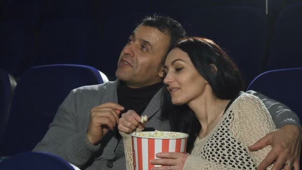 Thumbnail for Mature Happy Couple Enjoying Their Date at the Cinema Watching a Movie
