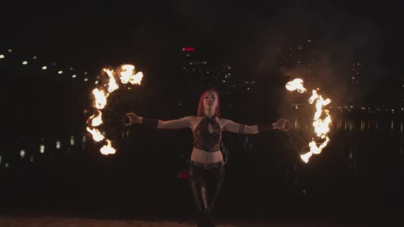 Thumbnail for Stylish Firegirl Spinning Fans During Fireshow