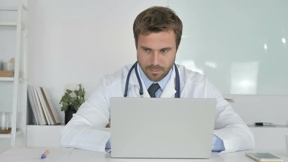 Thumbnail for Doctor Working in Clinic On Laptop