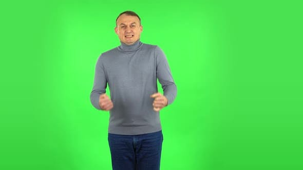 Thumbnail for Male Looking at the Camera with Excitement, Then Celebrating His Victory Triumph. Green Screen