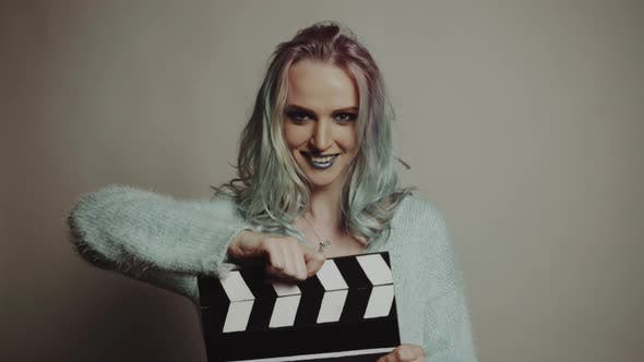 Thumbnail for Woman Playing with a Clapboard