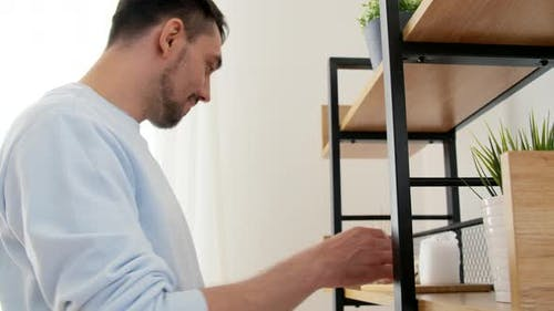 Man with Matchsticks Lighting Candles at Home