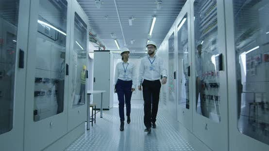 Thumbnail for Electrical Workers Walking in the Control Room