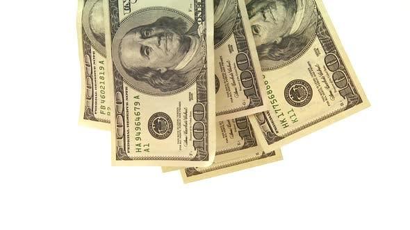 Thumbnail for Group of one hundred dollar bills hanging over white