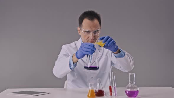 Scientist Works in Chemistry Lab with Reaction Tubes Performing Science Experiments