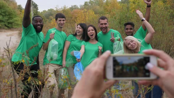 Thumbnail for Multiracial Volunteers Posing for Photo in Nature