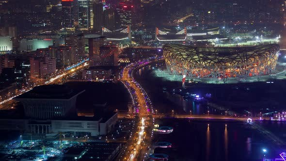 Thumbnail for Beijing Night Aerial Cityscape National Stadium in Beijing Olympic Park with Road Traffic China