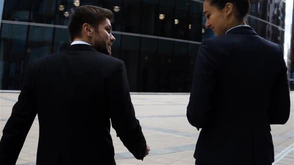 Thumbnail for Business Partners Men and Women Doing a Handshake