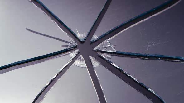 Thumbnail for Scratched Glass Broken Into Pieces. Close Up
