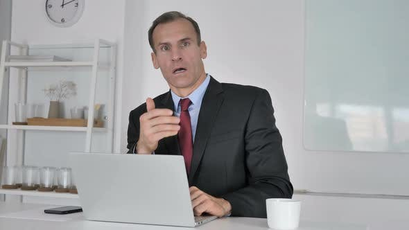Thumbnail for Shocked Middle Aged Businessman Wondering While Looking at Camera