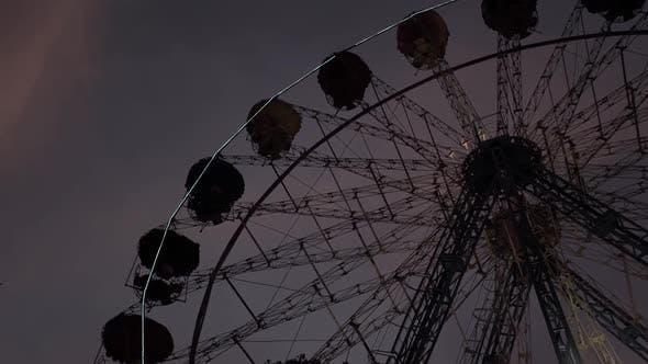Thumbnail for Rotating Ferris Wheel in a City Park. Evening. Dark. Kyiv. Ukraine